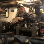 Joe tuning up our 1941 Hamilton Diesel Engine- the only one still operating in the world!